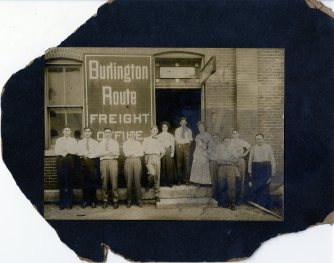 My great-grandfather (in the bow tie) in front of the railway station office in Keokuk, Iowa.